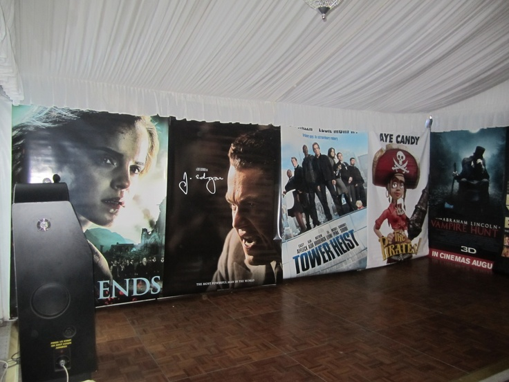 Large movie posters lined our marquee