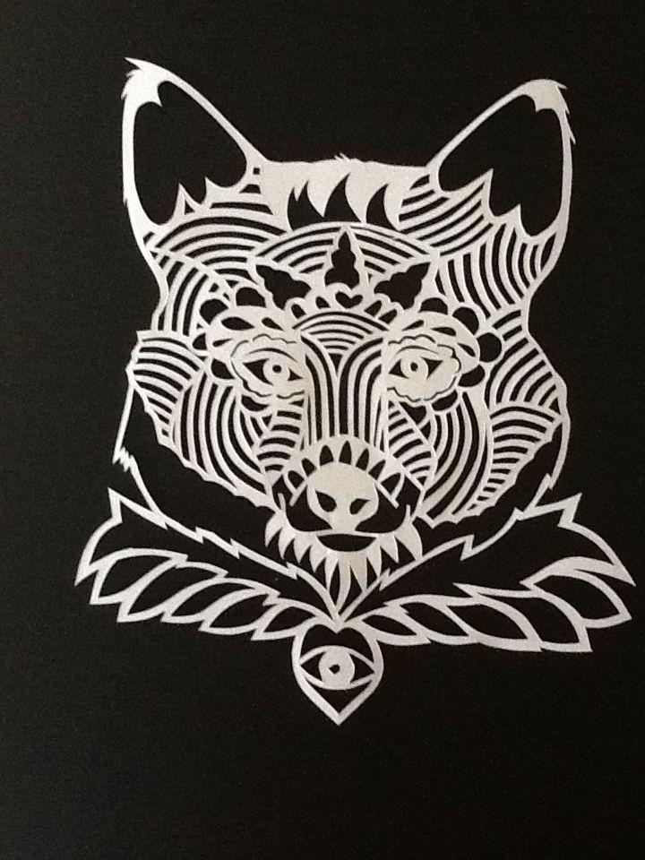 Handcut paper wolf design
