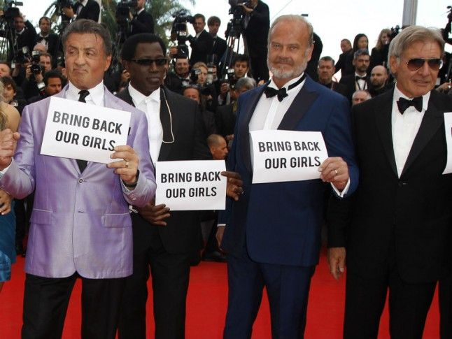 The cast of The Expandables 3 at the 2014 Cannes Festival, momentarily contributing to the #BringBackOurGirls Campaign (May 18, 2014): a surely explicit symbol of the problem.