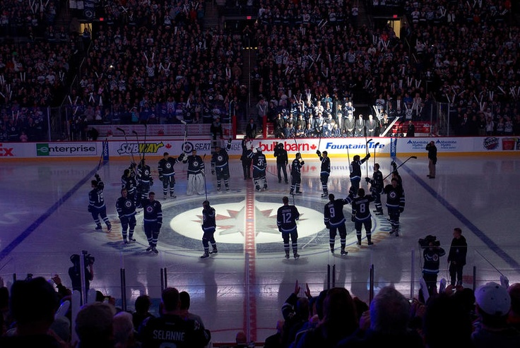 1/19/13: I love this. Instead of lining up on the blue line, the Jets circled their logo, then saluted the fans after their introduction.