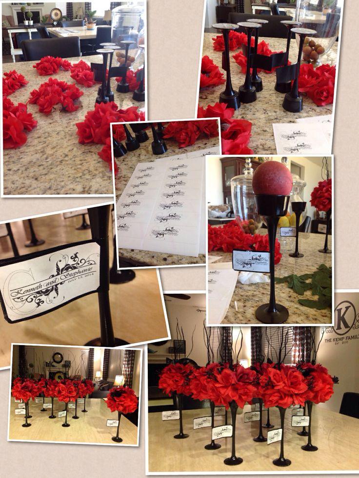 Diy wedding centerpieces black & red using tea light stands foam balls and silk flowers.
