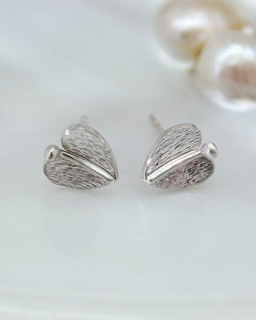 Cute and simple, these lovely silver leaf earrings are a must for everybody's jewellery box.   Suitable for all occasions including weddings, birthdays or as a mothers day gift.  The leaves have been hand saw pierced then lightly domed and completed with a silver vein and a lightly barked finish.  Overall measurements are 7.8mm wide x 9mm from top of silver wire to base of leaf.  The earrings are secured with sterling silver posts and butterflies.