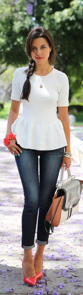 The peplum white long sleeve top is styled with cuffed indigo skinnies and salmon red glossy heels.