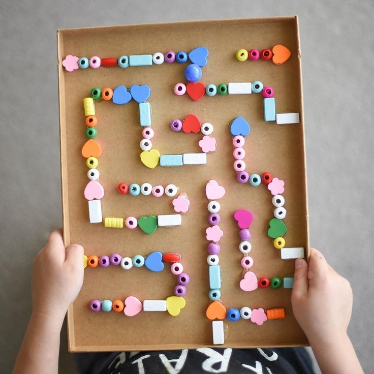 Here's the other side of our Button Geo Board I shared earlier today! (See previous post ) A Hand held Marble Maze made with wooden beads, a hot glue gun & the inner side of a cardboard box lid!  Another ✅ off my to-do list! This was so easy to make & is great for working on Hand Eye Coordination & Control!  You could cut holes at the top left & bottom right corners as a start & finish point (for the marble to fall through) + use straws &/or paddle pop sticks instead of beads.  Have you e...