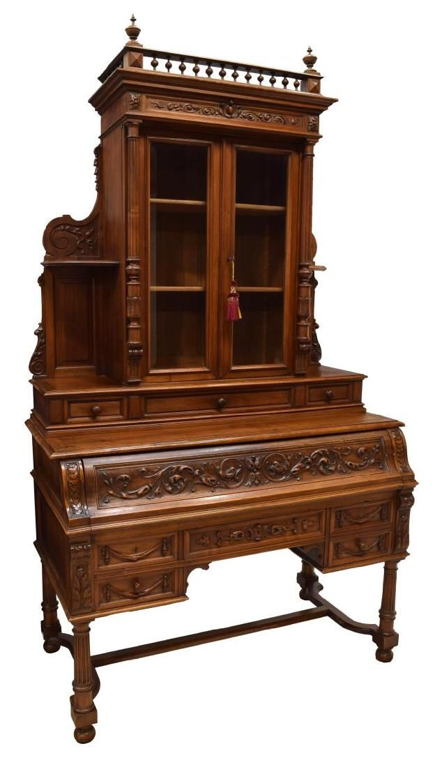 """French mahogany bureau bookcase, late 19th c., a galleried finial accented crest rail over two glazed doors, with flanking columns, opening to shelves, the lower pat with a drop front pull out leather writing surface with a three drawer gallery, four lower exterior drawers, one with locking box, all rising on stretcher joined bun foot turned legs, approx. 89""""h, 50""""w, 26""""d *"""