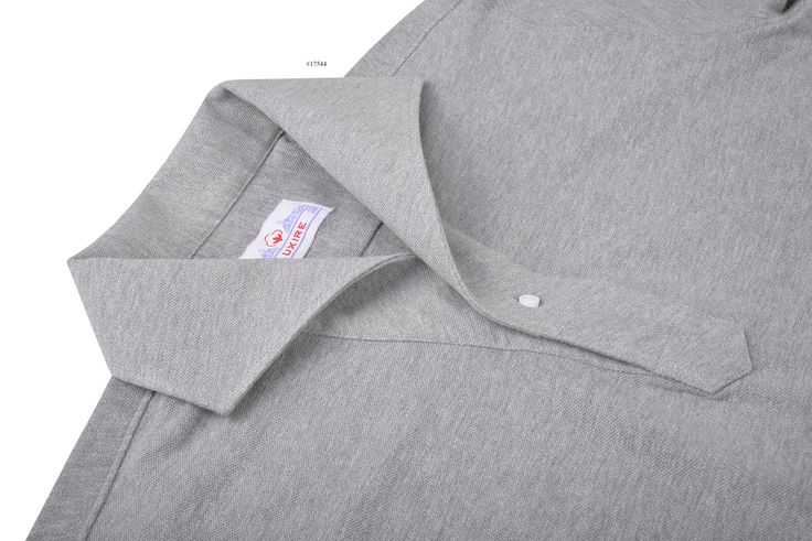 Heather Grey Pique pullover shirt from Luxire with its soft and durable personality presents a soothing shade with an elegant colour style. The breathable pique keeps you comfortable and cool through the season: https://luxire.myshopify.com/admin/products/4833032132?show_all_images=true Features: Eidos lupo collar and 1-button cuffs.