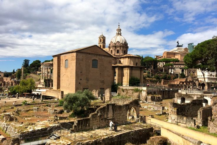 September skies are blue with wispy clouds, and the weather is not too hot - perfect for exploring Rome on foot. This is the Roman Forum, as seen from the via dei Fori Imperiali