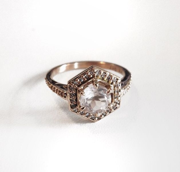 How beautiful is this!! 18ct yellow gold hex engagement ring set with a rose quartz and surrounded by white diamonds. Someone is a lucky girl x Shop this style here: http://meadowlarkjewellery.com/product/hexagon-engagement-ring/