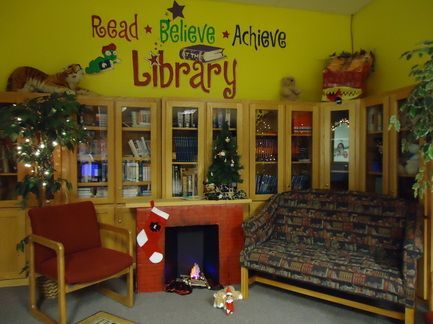 Image result for above shelf display in school library ...