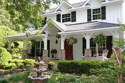 White Colonial:  red front door; big front porch; stone; black shutters; landscaping