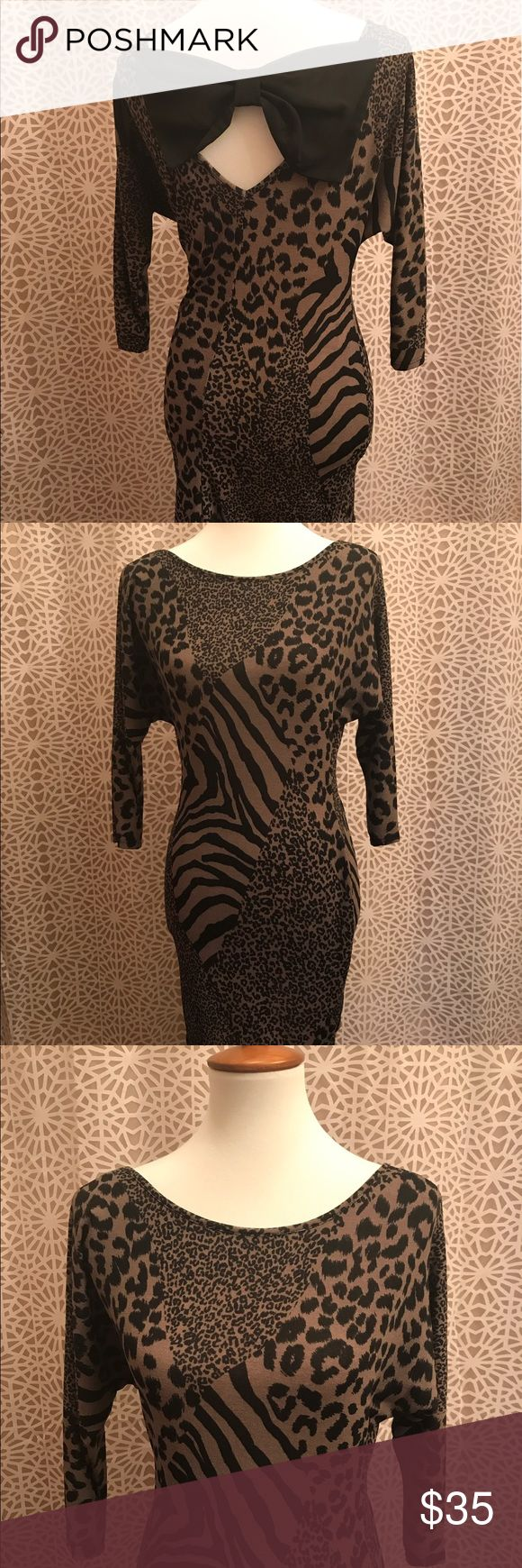 🆕 Sassy Animal Print Bow Back Dress Brand new. Features an adorable bow back design and sassy animal print. 96% polyester and 4% spandex. Made in America. Dresses Long Sleeve