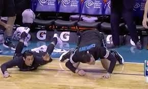Jeremy Lin and Frank Kaminsky dive to the floor in disbelief after Marvin Williams' poster dunk