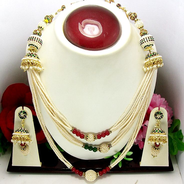 This antique chid necklace is based on three string base, each string is based on series of pearl seeds one above the other. All the strings are highlighted with jaal puwai balls in various sizes. The ends of the strings are decorated with meenakari tokris which are edged with moti bandhai and decorated with octan stones over them.