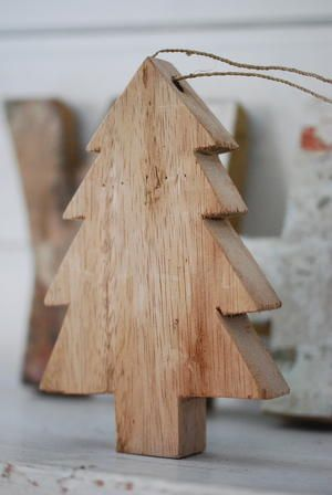 wooden Christmas tree. I like this! Inspiration only, but I can easily copy this and use a jigsaw to cut it out, then drill the hole to thread a string through it. Hang it on a tree, door knob, cabinet, coat hanger, etc. Easy way to decorate for the holiday throughout the house.