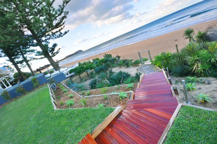 Deck and steps lead straight onto the beach.