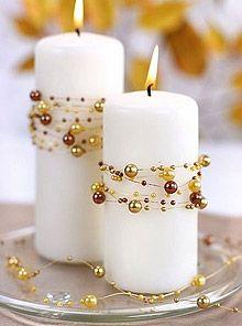 La Guirlande de Décoration Perles articulée. Décorez votre évènement grâce à mariage.fr, numéro 1 des boutiques de décoration mariage en France. décoration mariage, decor mariage, wedding, bougie, candle, pearls, gold, doré