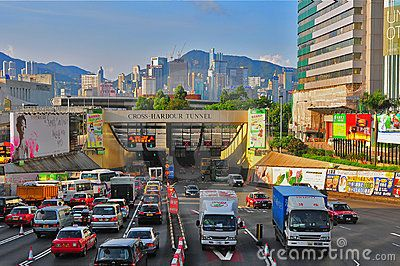 Various vehicles rushing through  the multi lane connected to the cross harbor tunnel in hong kong
