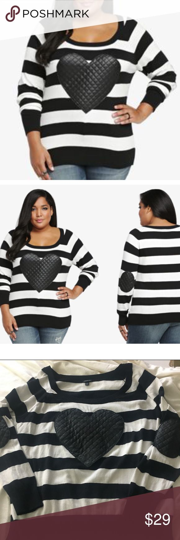 Torrid Faux Leather Heart Sweater Plus Sz 3X So soft in cashmere-like cotton, this faux leather heart plus size sweatshirt from Torrid gives cozy a fun twist. This black and white striped pullover cops an attitude with a quilted faux leather heart on the front and quilted faux leather elbows. Pair it with skinny jeans or a faux leather skater skirt and boots for the perfect Fall look. torrid Sweaters Crew & Scoop Necks