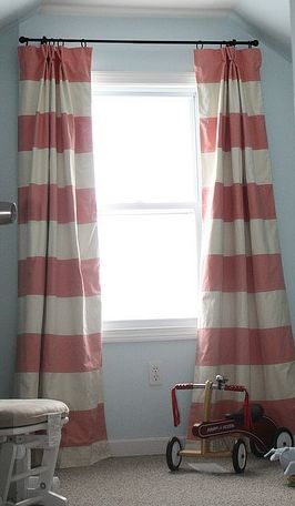 Blue walls, pink and white curtains