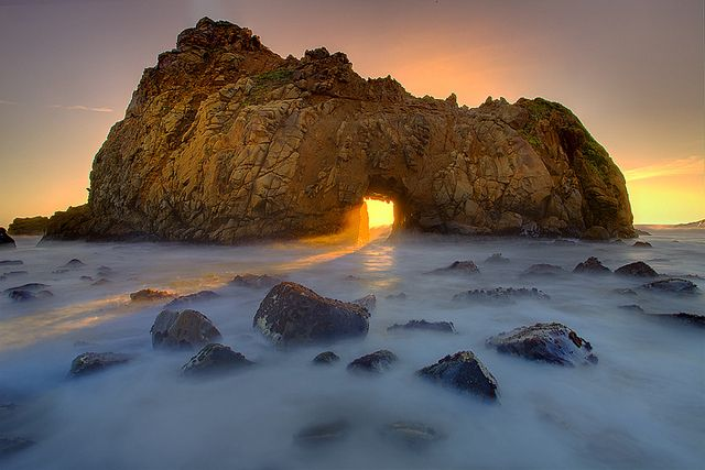 I just got back from a week in Yosemite and Big Sur .. we were lucky enough to get a huge dumping of snow in Yosemite the day we arrived and later we moved on to the coast.. the following is an image from the iconic location of Pfeiffer Beach.. in the months of Jan and Feb the sun lines up with the hole in the wall and really makes this an unique scene….  www.kevinmcnealphotography.com or https://www.facebook.com/kevinmcneal30