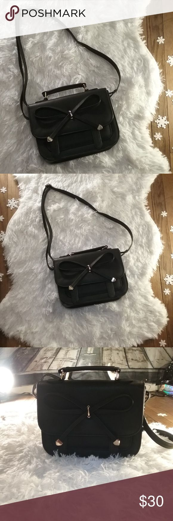 "ASOS Bow Satchel Bag ASOS Bow Satchel Bag Matte Black, Excellent Condition, & Absolutely Gorgeous! 100% Polyurethane, Leather-look Fabric H: 17cm/7"" W: 23cm/9"" D: 9cm/4""  Not a Poshmark member yet? Enter referral code WHTELEPHNTRVIVL while setting up your account and get $5 off your first purchase! ASOS Bags Satchels"