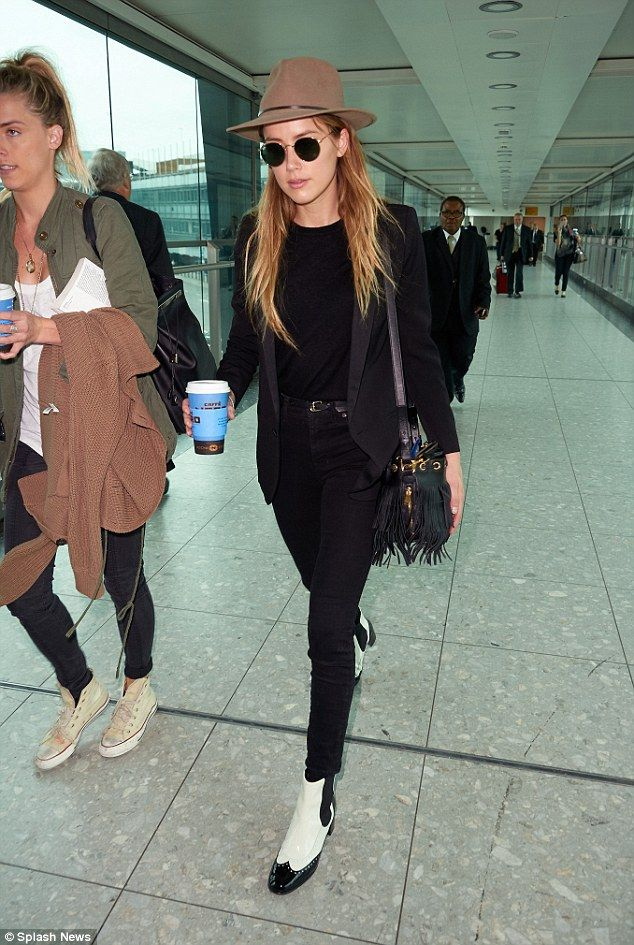 Star style: Amber Heard proved her fashion credentials nailing airport chic as she flew in...
