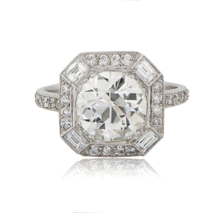 Wow! A beautiful platinum engagement ring set with an Old European cut diamond. Part of the Estate Diamond Jewelry Collection.