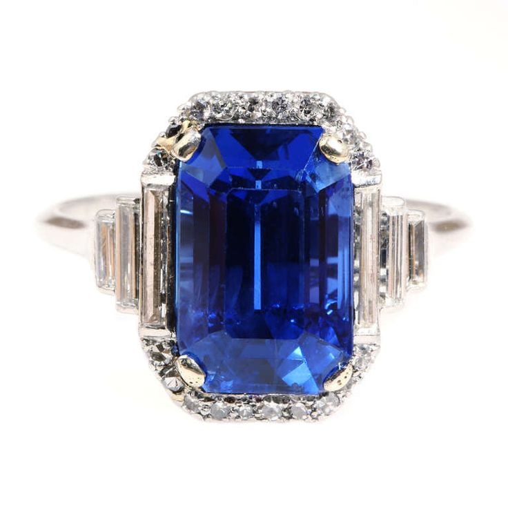 Art Deco Natural Sapphire Diamond Ring. Art deco sapphire and diamond ring. Circa 1920's. English in origin. 6.26 carat central sapphire stone shows no signs of treatment of any kind. The sapphire is flanked by 6 baguette diamonds and surrounded by 18 single cut stones all set in a handmade platinum setting. The stones have been certified by The Gem & Pearl Lab of London, England.  England, c 1920s
