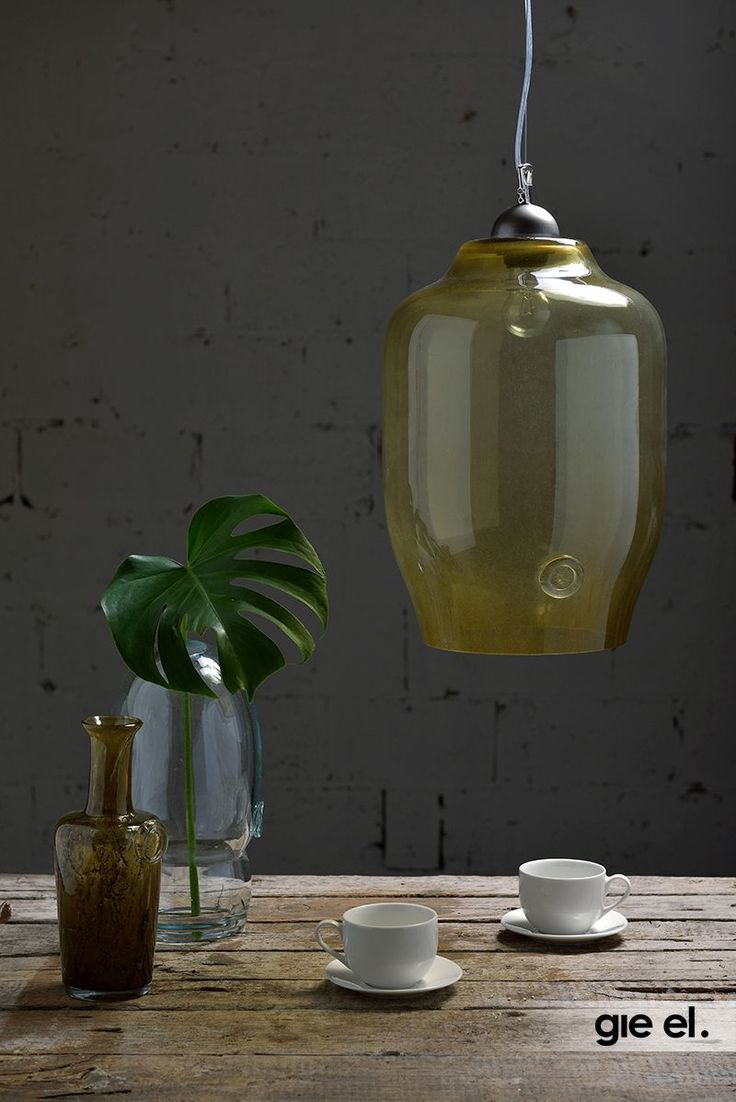 Beautiful glass pendant lamp in olive green colour. Gie El Home