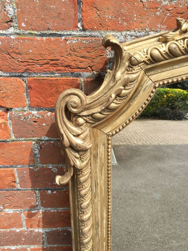 A Delightful Antique 19th Century French carved wood & gesso shaped top gilt Mirror