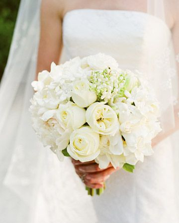 bouquet mixed classical elegance with a hint of contemporary. The different white flowers -- gardenias, stephanotis, lily of the valley, polo roses, and peonies -- were arranged in clusters