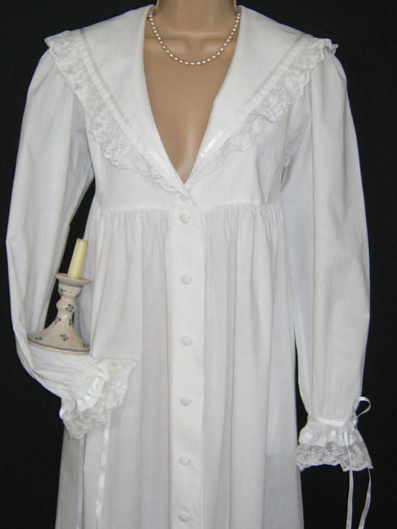L A U R A A S H L E Y  I dont like ephemeral things, I like things that last forever  A FULL-LENGTH MORNING ROBE IN REGENCY EMPIRE DESIGN. MEDIUM WEIGHT 100% COTTON, THE GOWN HAS FULL FRONT FASTENING WITH TEN SELF-COVERED BUTTONS WITH TWO REPLACEMENTS STILL STITCHED INSIDE LOWER
