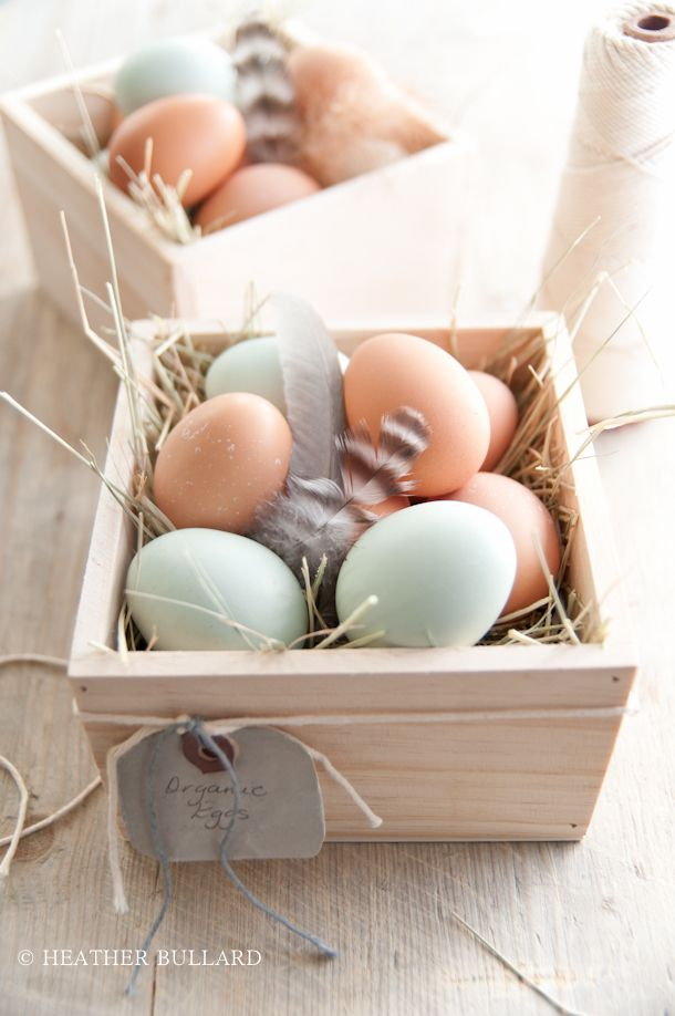 Organic eggs nesting in small wooden crates makes for an interesting #easter display.