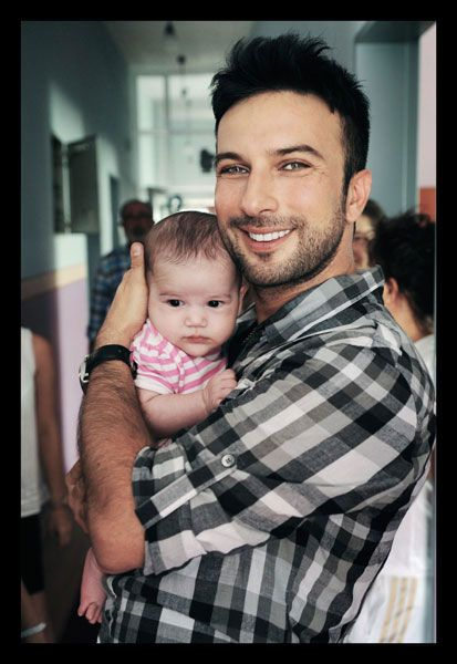 Tarkan with a beautiful turkish baby.. does it get any better?