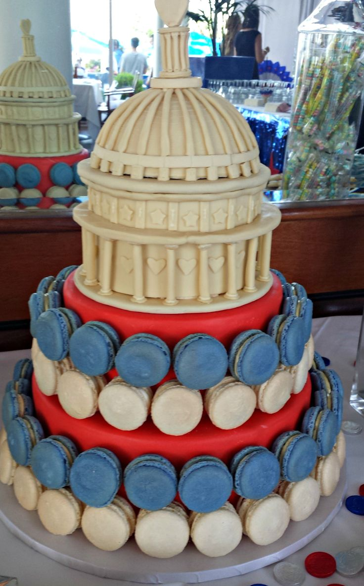 Red And White Macarons On Cake