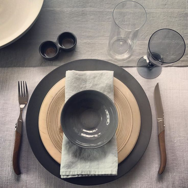 Yeah! I get to play with #tablesettings now that I have my new #dinnerware and #vintagefinds.  I'm a big fan of #greyscale with a soft touch of blue. #porcelain #dinnerplate and bowl #stoneware #servingbowl and #saltandpepper #pinchpot #glassware and #vintageassware GORGEOUS #washedlinen #europeanlinen #napkins #tablerunner and #tablecloth. With the #piècederésistance #midcentury #woodplate by #saarinen #madeinfinland. I'm in love!! #setthetable #supportlocal #shophamptons