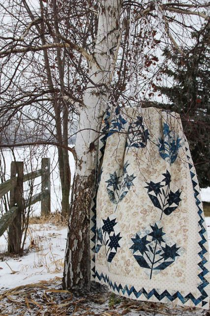 Laundry Basket Quilts Blog ~ like the neutral print background with the blue & white