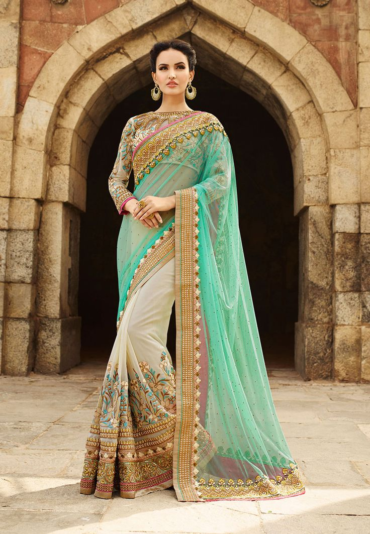 Buy Pastel Green and Light Beige Net and Faux Georgette Saree with Blouse online, work: Embroidered, color: Light Beige / Pastel Green, usage: Wedding, category: Sarees, fabric: Net, price: $194.53, item code: STN1745, gender: women, brand: Utsav
