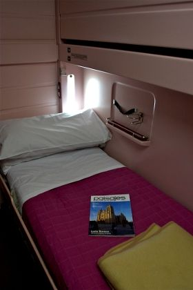 Traveling first class on the Eurail---private cabin with own bed, built-in alarm clock, two blankets and a comfortable pillow, bottles of water, and soap in the private bathroom with shower. There was space for luggage under the bed. Extremely do-able!