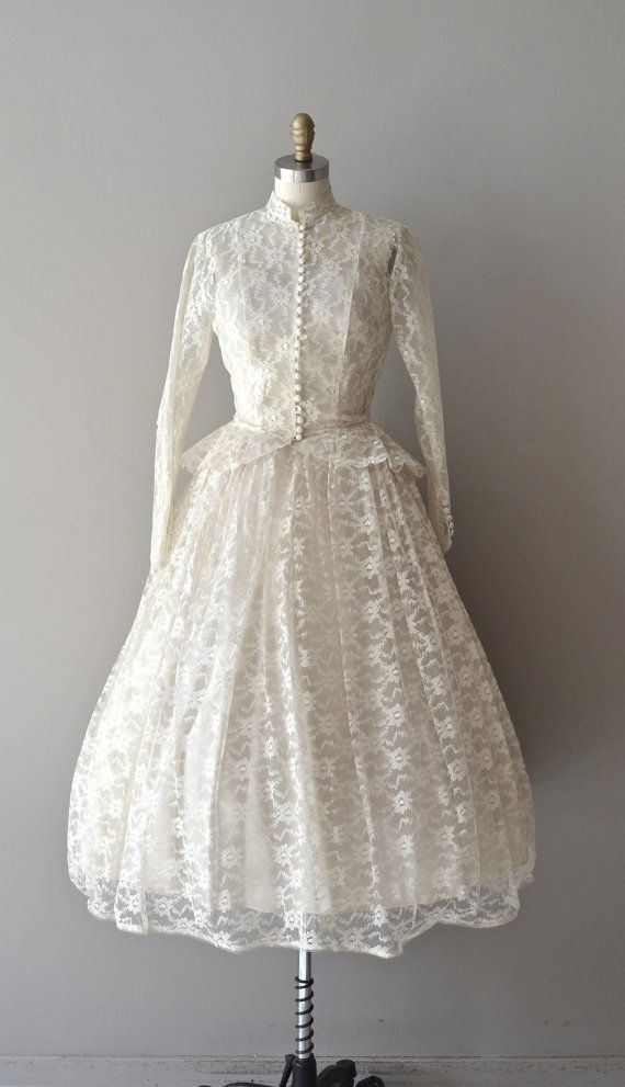 Strapless lace 1950's wedding dress with long sleeve button front jacket