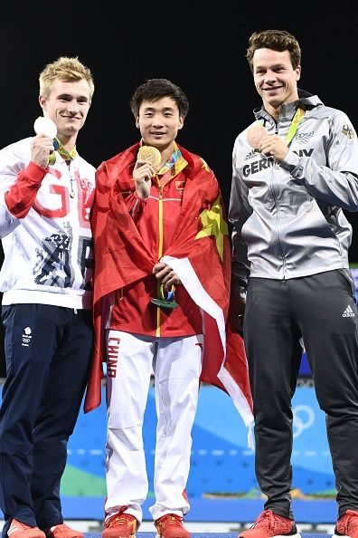 Gold medallist China's Cao Yuan poses with silver medallist Great Britain's…
