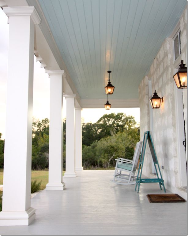 Gray painted floors and blue painted roof is typical of houses found in the  Texas Hill Country. Like the blue ceiling