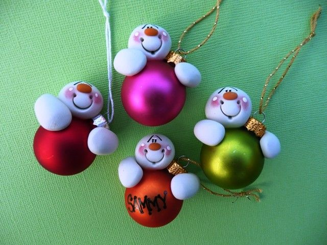 """Personalized Clay Snowman Bulb Christmas Ornaments... this is a """"for sale"""" creation on Etsy. I just want to remember this for some family holiday ideas."""