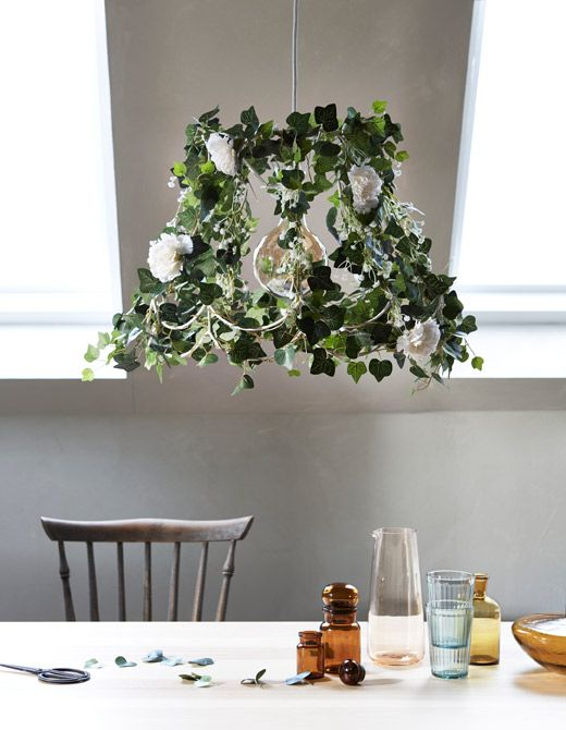 Try a different way to bring greenery into the home by updating an old lamp with artificial flowers and green plants! IKEA has a big variety to choose from!