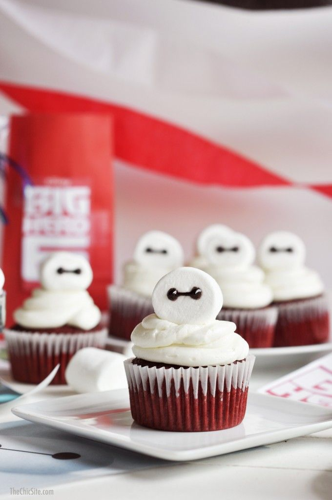 Baymax from Big Hero 6 gets the cupcake treatment with these easy to make birthday party Big Hero 6 Cupcakes! Use cake box mix and jumbo marshmallows!