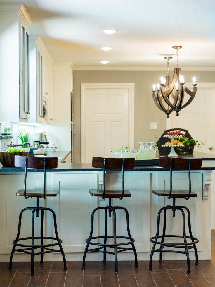 Designers Chip And Joanna Gaines Chose Rustic Touches Including The Bar Stools Pendant Lights To Add Warmth This Kitchen Trim Work On