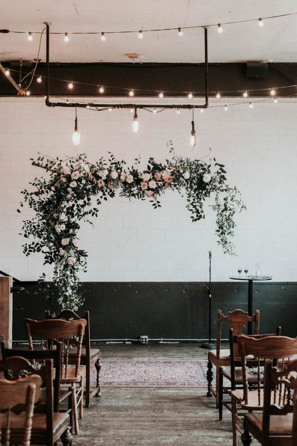 Asymmetrical floral ceremony backdrop | Image by Karra Leigh Photography