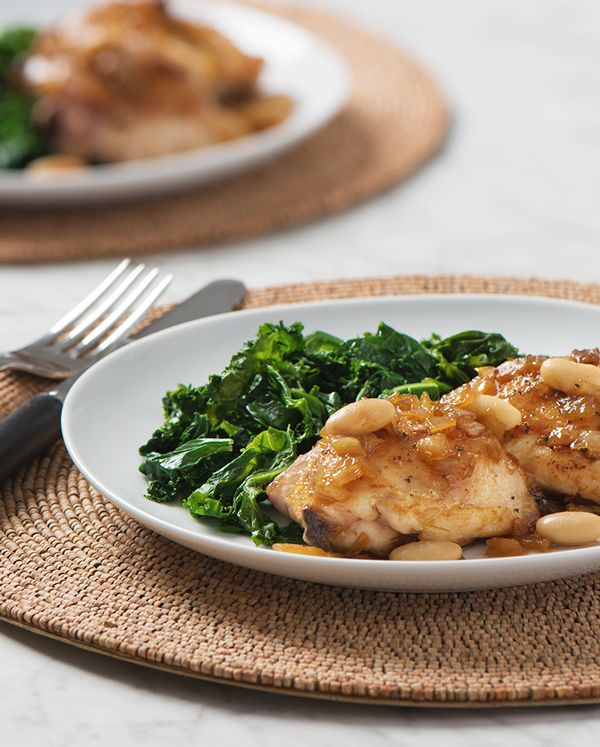 Braised Chicken with White Beans and Kale: a delicious balance of hearty and heart healthy.