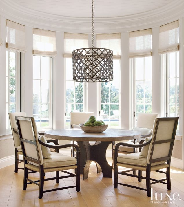 Here, a gracious and inviting Brentwood home's dining room. A pendant by Ironies hangs above a Gregorius Pineo table, which anchors the sunny breakfast nook. The armchairs are from Formations. See more: http://www.luxesource.com.