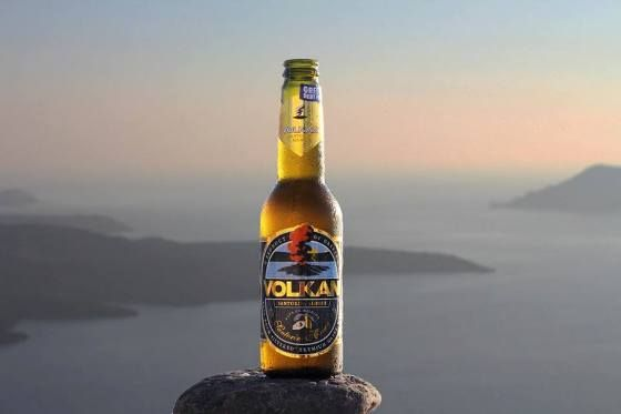 A volcano of a beer. Produced on the island of Santorini, 'VOLKAN' has been available in a blonde (Santorini Blonde) and a black (Santorini Black) version since February 2012. Its unique features include originality in the making, and local products peculiar to the Cyclades: the rare grape honey from Santorini, citron from Naxos, and water filtered in volcanic stones.